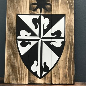 fenwick shield on wood board
