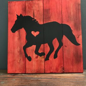horse on red wood paneled background
