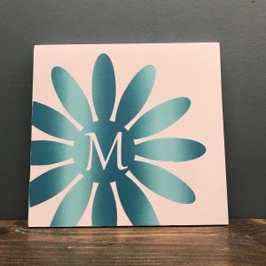 flower monogram and initial on wood