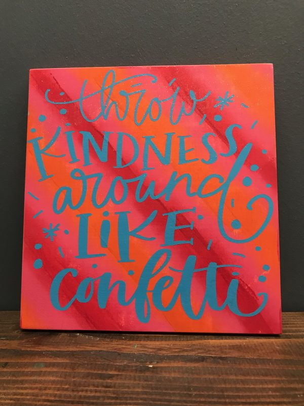 throw kindness like confetti on wood sign