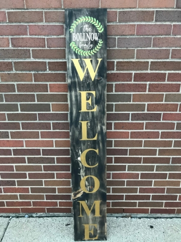 welcome with leaves on wood sign