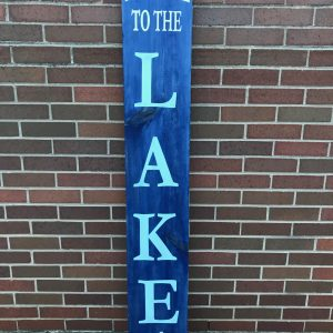 welcome to the lake blue wood sign