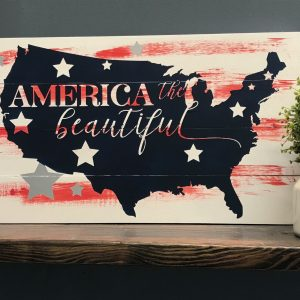 america the beautiful on wood paneling