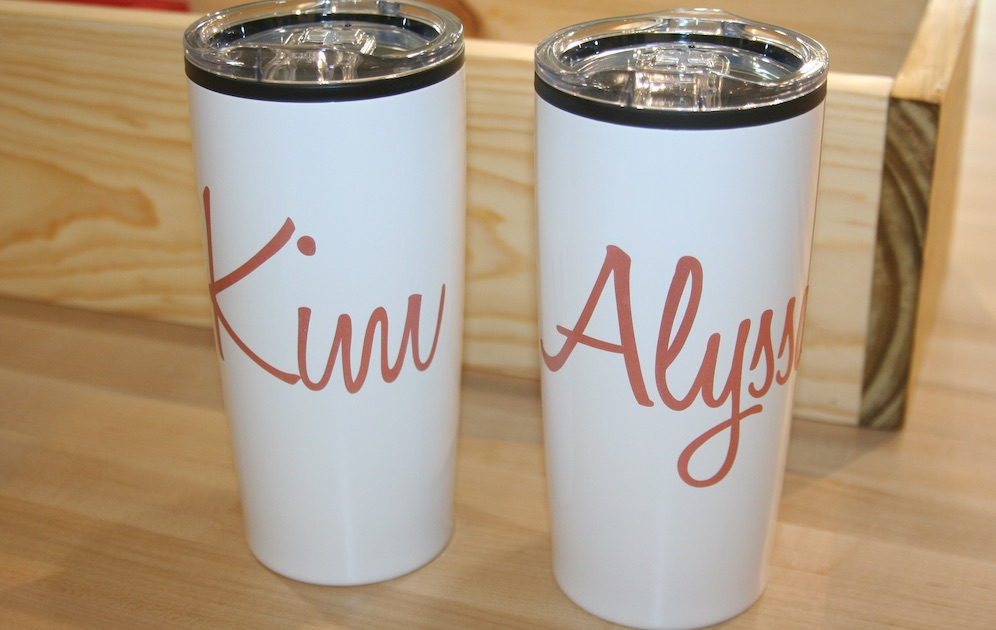 White coffee mugs with girls' names written in pink
