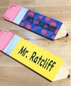 Yellow and blue-and-pink polka dot pencils with teacher names