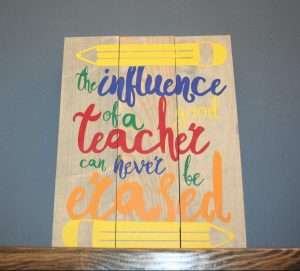"""Sign that says """"The influence of a good teacher can never be erased"""""""