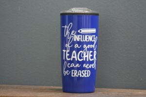"Blue coffee mug that says ""The influence of a good teacher can never be erased"""