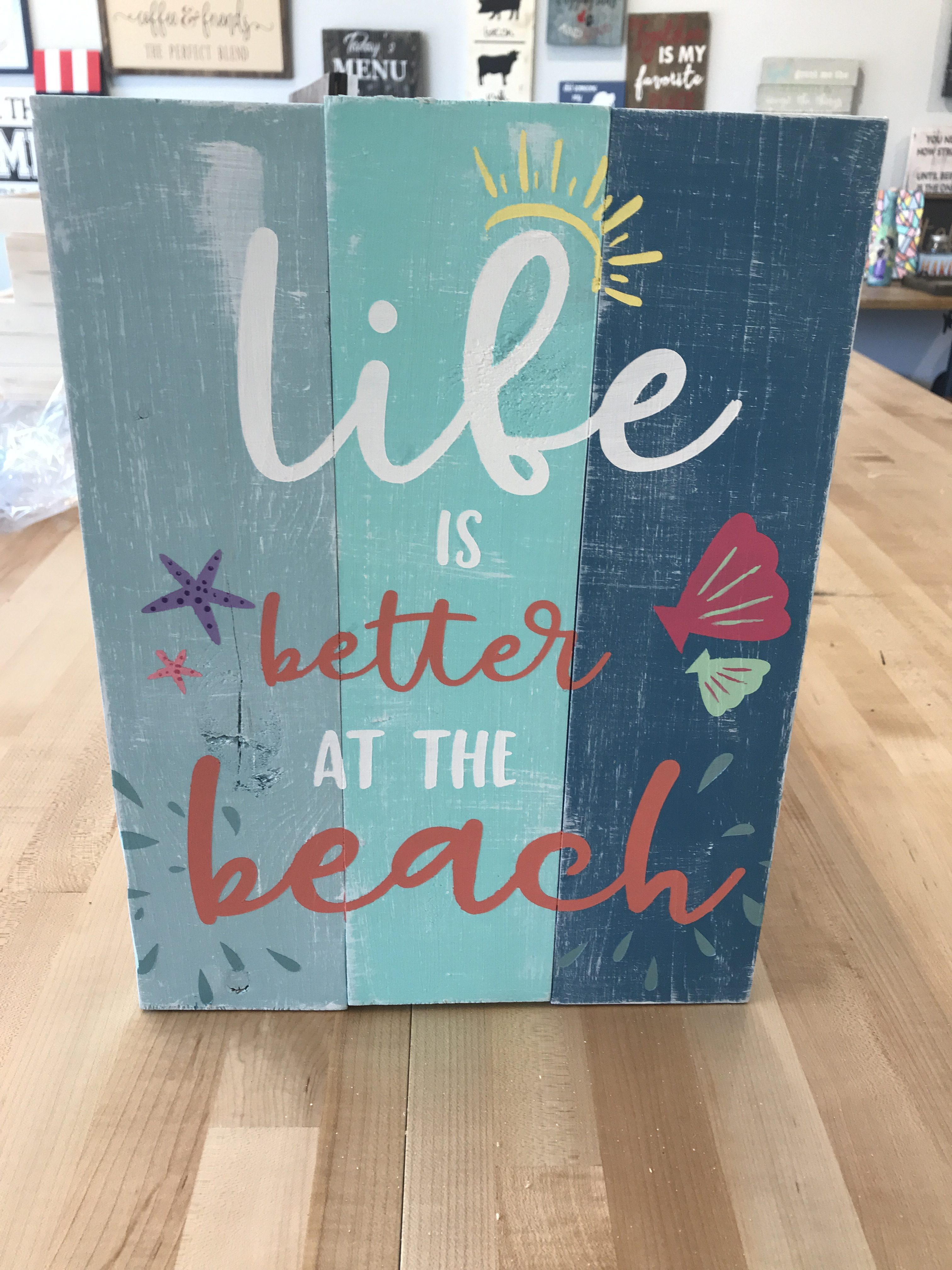 life is better at the beach on wood paneling