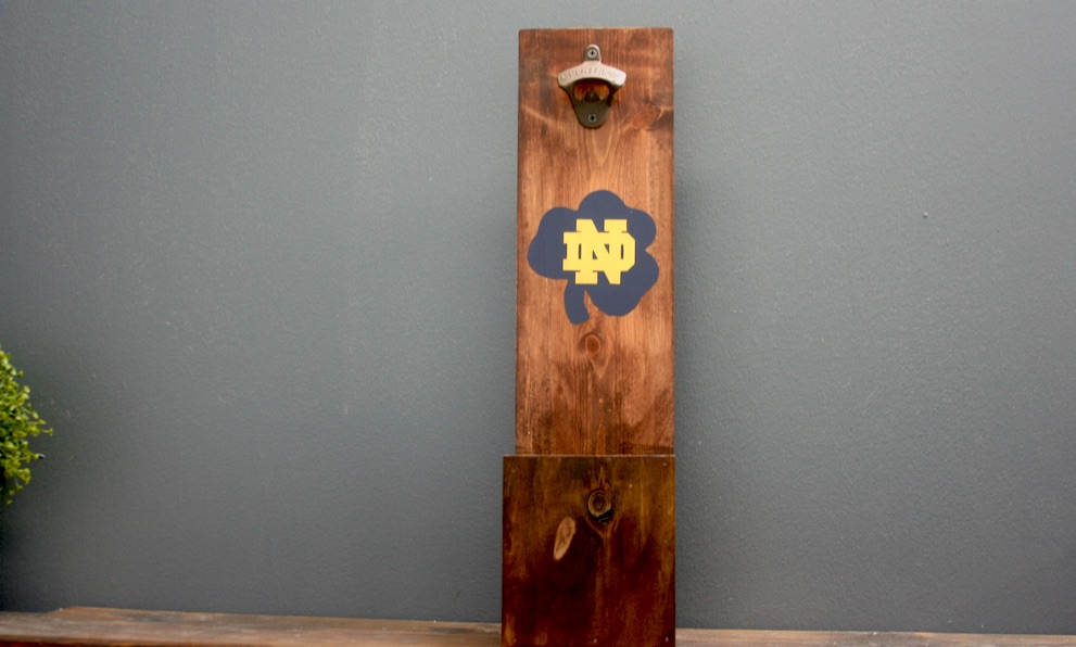 Wooden bottle opener with the Notre Dame logo