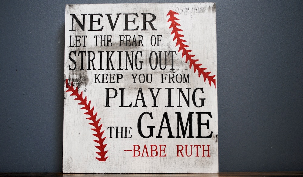Wood sign painted like a baseball with a Babe Ruth quote