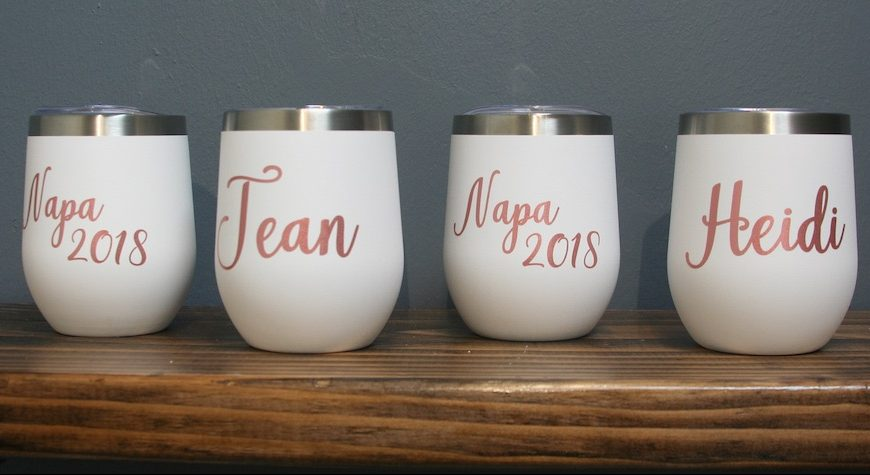 To-go wine tumblers in white with pink writing