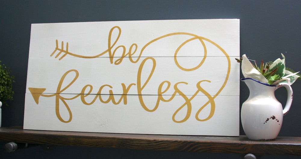 White sign that says be fearless