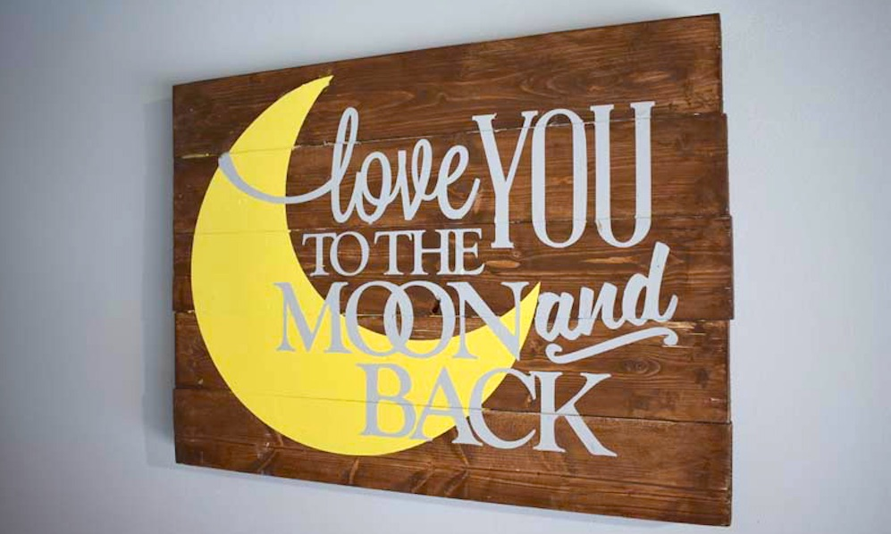 woon sign with a moon that says love you to the moon and back