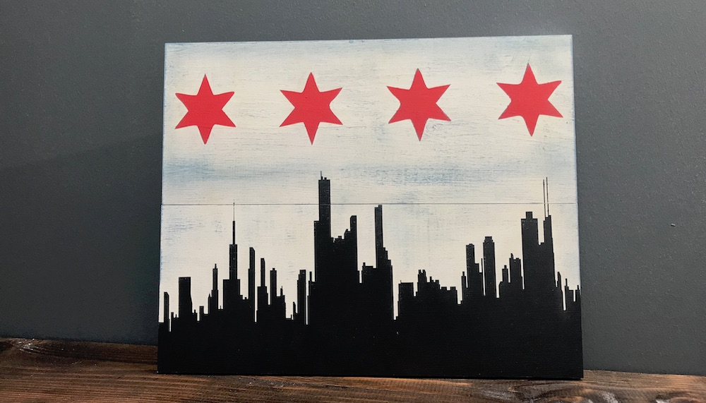 Wood sign with Chicago skyline and red stars from Chicago flag