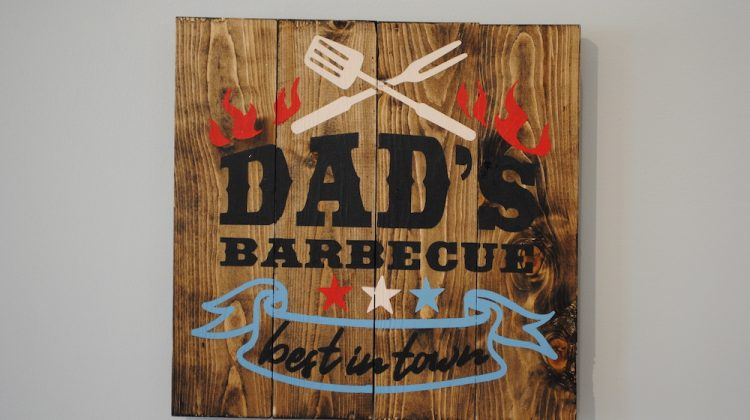 Wood sign that says Dad's Barbecue