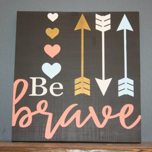wood sign that says be brave