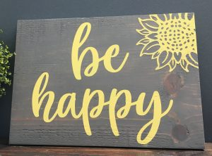 Wood sign that says be happy