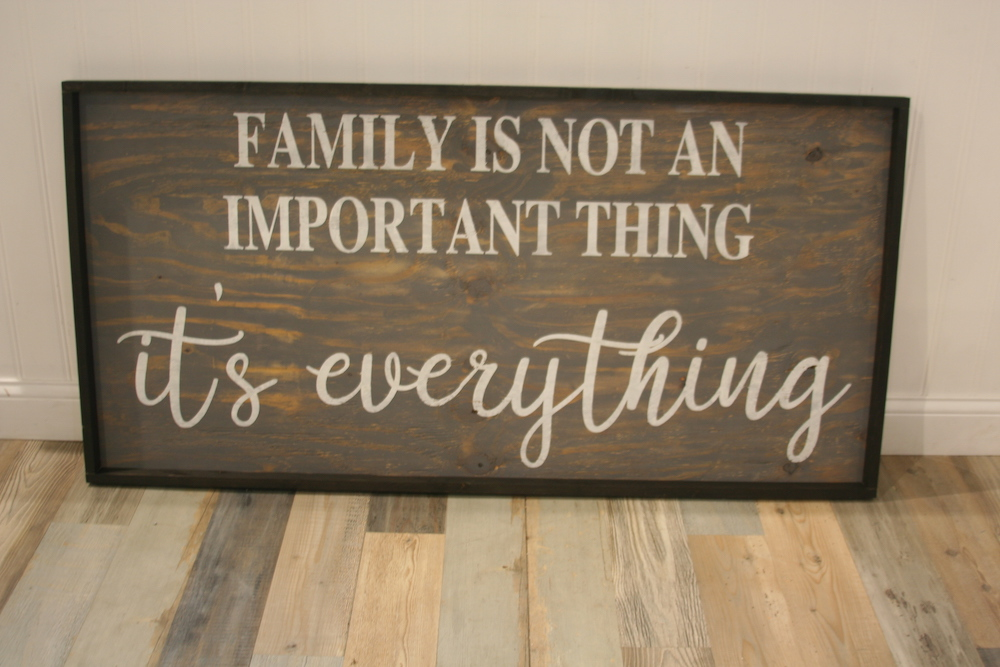wood sign that says family is not an important thing it's everything