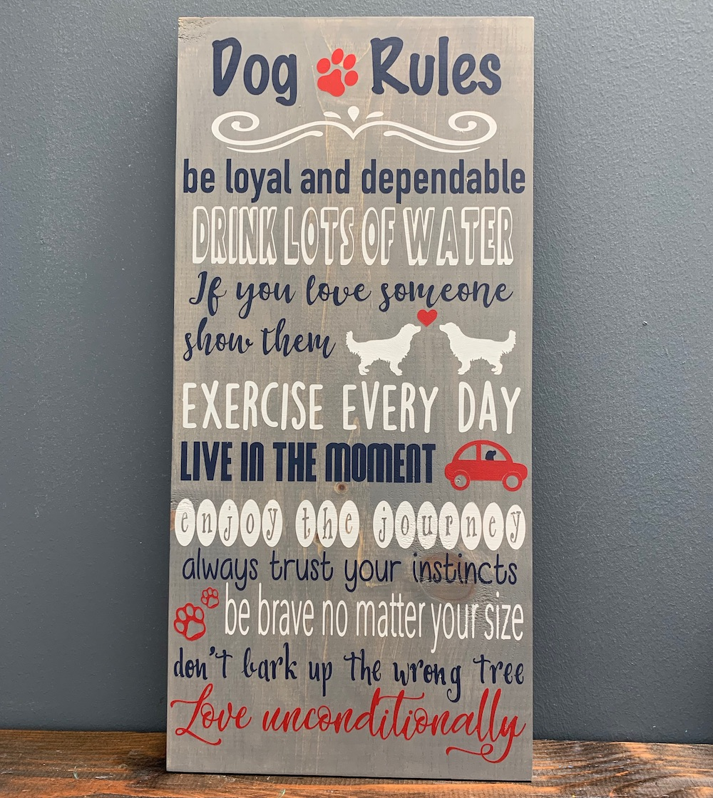 Wood sign with quote about dog rules
