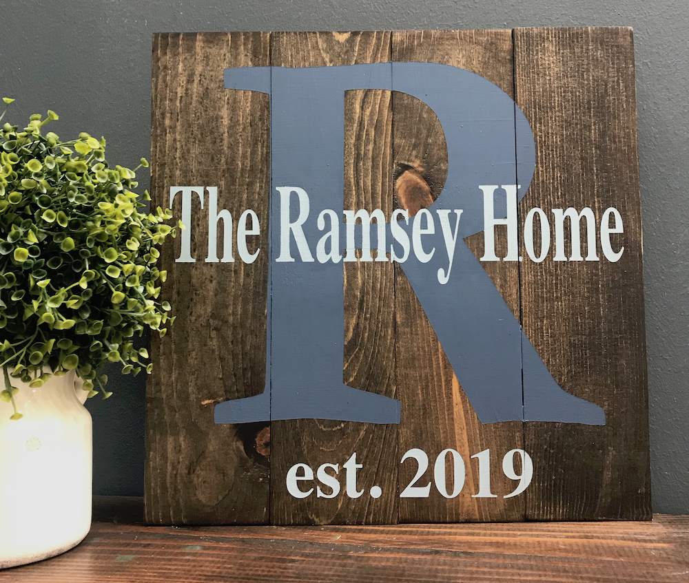 Wood sign that says the ramsey home est. 2019